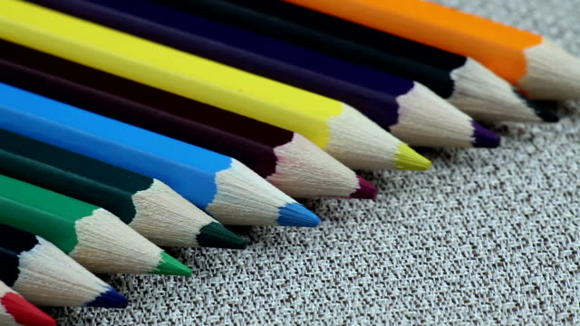 Colored Pencils Twelve Pieces Lie on White Cloth video