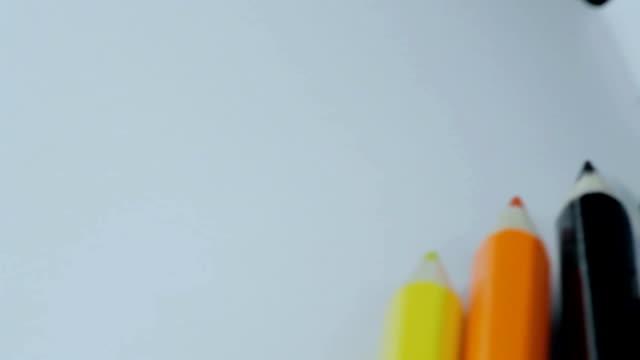 Colored Pencils Twelve Pieces Lie on White Paper video