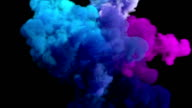 Colored smoke explosion on black video