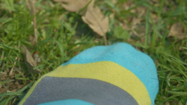 Colored sock feeling the green grass New York Central Park video