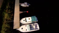 Colorful and white boats docking in the harbor video