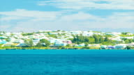 Colorful Bermudian Buildings while Passing Tropical Island video