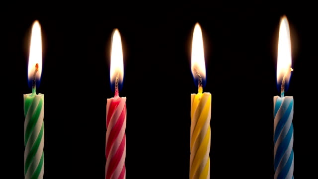 Colorful Birthday Candles Burning Down video