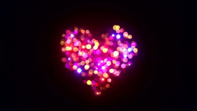 colorful bokeh lights heart shape loopable animation video
