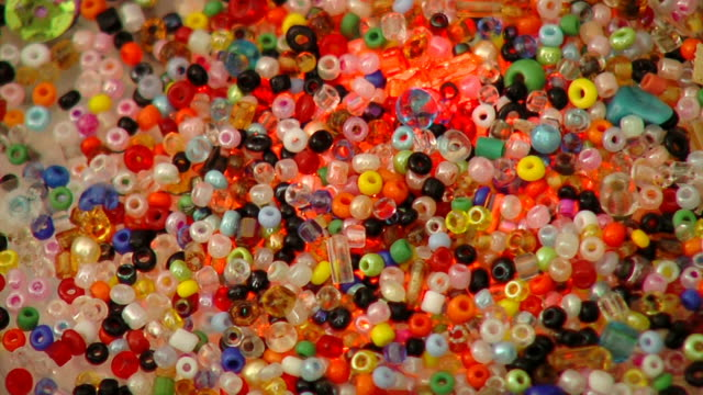 Colorful bright jewelry beads - craft supply video