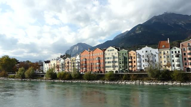 Colorful building along Inn river in Innsbruck, Austria video
