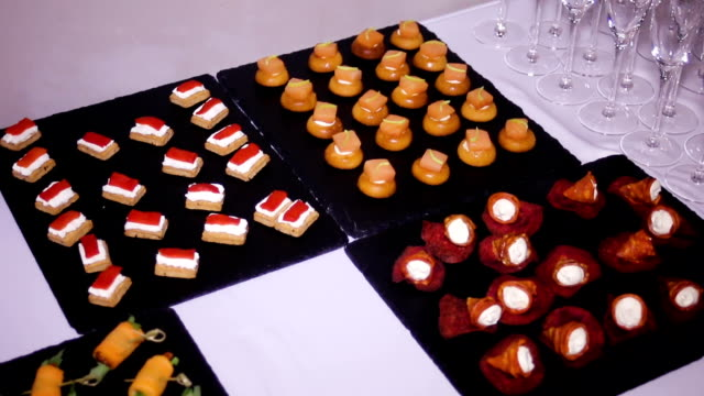 colorful canapes are on the black tray video