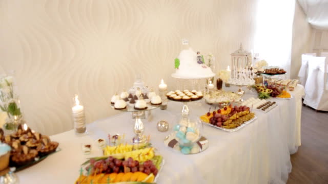Colorful candy bar at a wedding hall. Close up shot. video