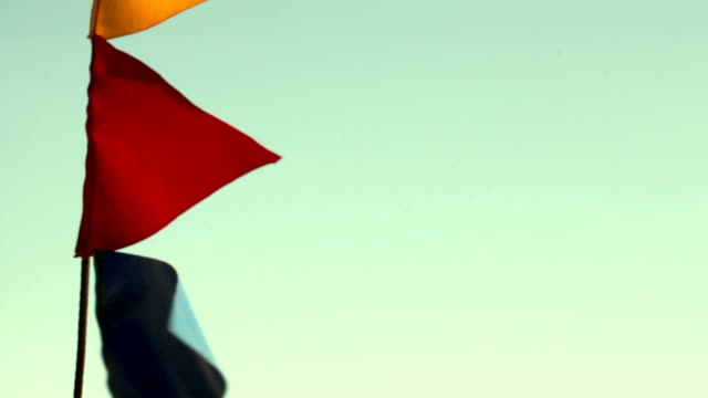 Colorful flags against the blue sky video