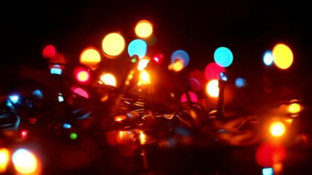 colorful flashing christmas lights and reflection seamless loop video