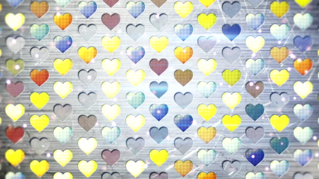 colorful flashing heart shapes loopable background video