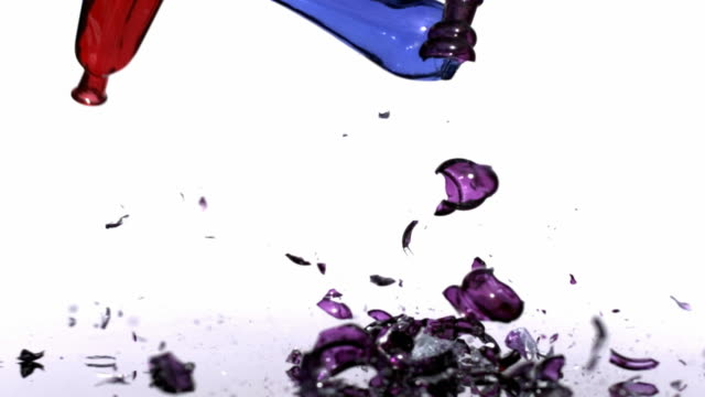 Colorful glass bottles falling and breaking video