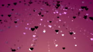 Colorful Heart Particles flowing in the wind. video