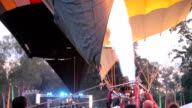 Colorful hot air balloon as it is inflated for flight, burning burner video