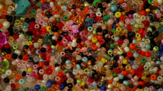 Colorful jewelry beads and light video