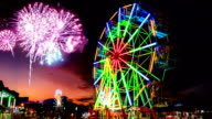 colorful light ferris wheel with fireworks video