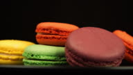 ROTATION: A Colorful Macaroons are rotating on a black dish video