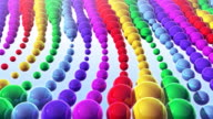 Colorful moving metallic spheres - background. video