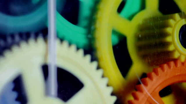 Colorful Plastic Gears Rotate Synchronously video