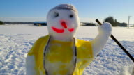 A colorful snowman with yellow shirt on it video