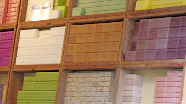 Colorful soap bars on the shelf of the store video
