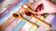Colorful spices in wooden spoons video