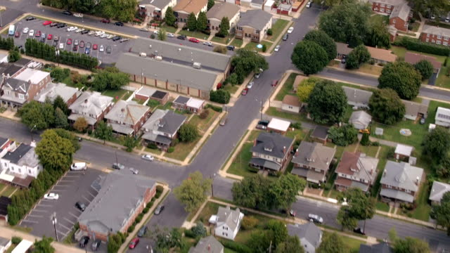 AERIAL: Colorful streets of residential neighborhood in luxury suburban town video