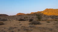 Colorful sunrise over the Namib desert, Aus, Namibia, Africa. Clear sky, glowing rocks and hills, time lapse video. video