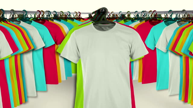 Colorful t-shirts hanging on a rack video