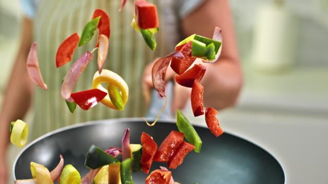 SLO MO colorful vegetable pan shake video