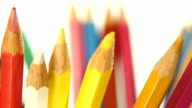 Colour pencils isolated on white, rotation, close up video