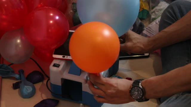 Colourful balloons pumping video