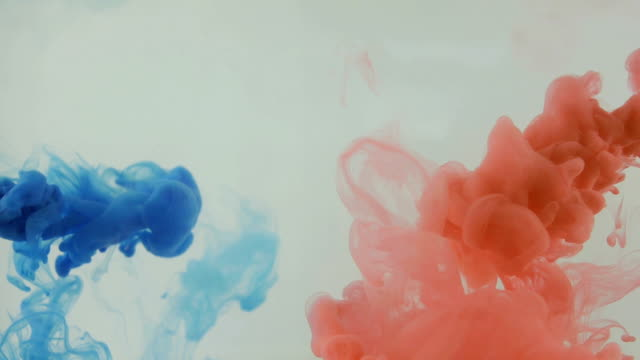 Colourfull background. Blue and red ink dropped in water. Slow motion video