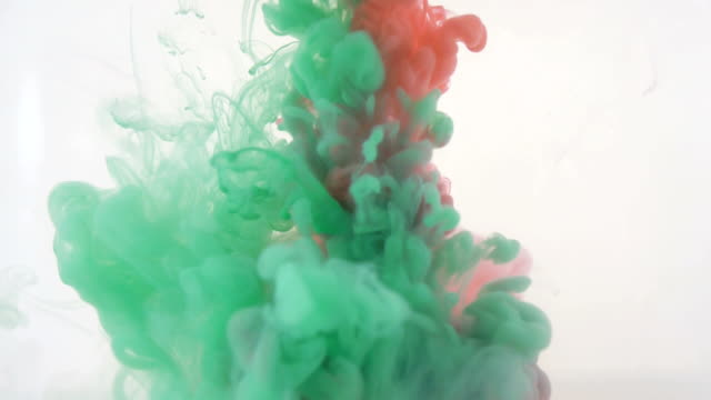 Colourfull background. Red and green inks dropped in water. Slow motion video