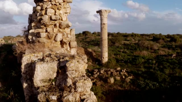 Column and remainings of wall on place of temple of Zeus antique town Salamis east Cyprus Famagusta video