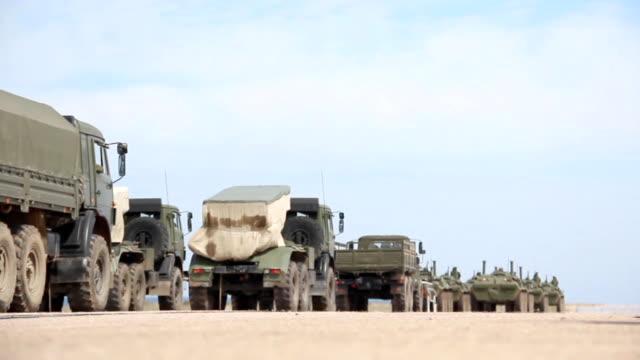 Column of military equipment video