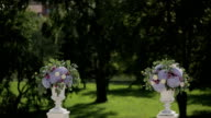 Columns of flowers for wedding ceremony. Sequence 2 shot video