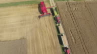 Combine Harvester Discharging Wheat Flyover video