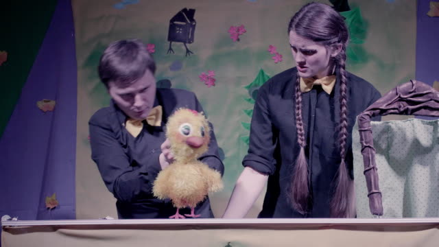 Comic performance of puppets theater. Toy chicken video