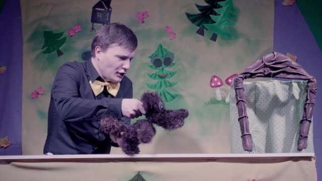 Comic performance of puppets theater. Toy dog. video