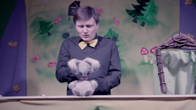 Comic performance of puppets theater. Toy rabbit. video