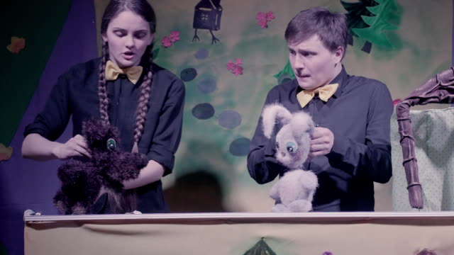 Comic show of puppets theater. Toy rabbit and dog. video