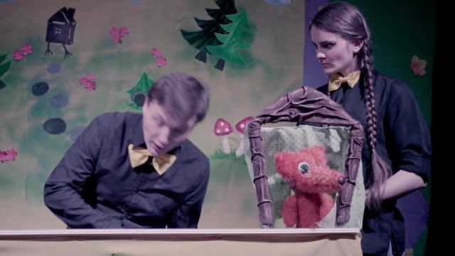 Comic show of puppets theater. Toy rabbit and fox. video