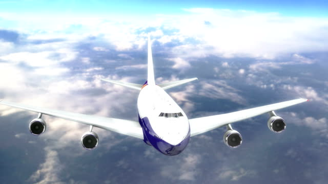 commercial airplane flying above the clouds video