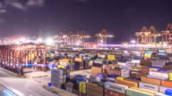 commercial dock with cargo containers in Shanghai in cloud sky at night . time lapse 4k video