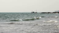 commercial fishing boat on the horizon video