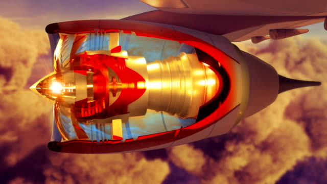 Commercial jet airplane flies above clouds with fly through engine sunset video