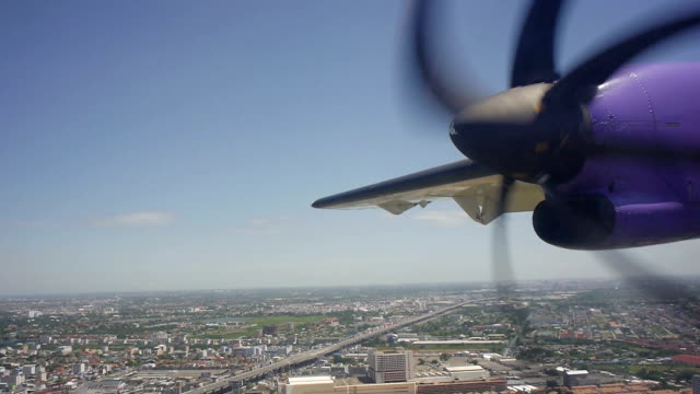 Commercial Propeller Airplane flying over land video