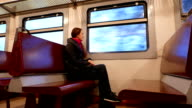 Commuter travel in old train, bored woman look at curriage window video