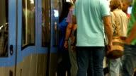 Commuters Boarding Subway Train (4K/UHD to HD) video